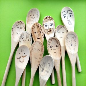 wooden spoons with faces drawn on them for a story